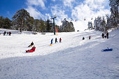 Troodos, Cyprus- January 12, 2019 - People at ski lift resort on the mountain range.