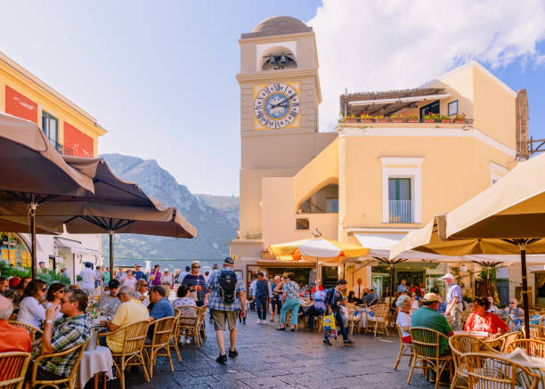 people at square with church in old town of capri - climate clock imagens e fotografias de stock