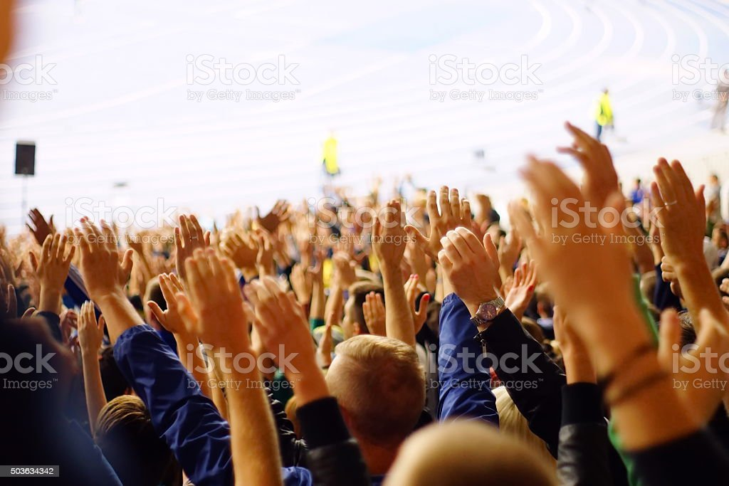 People at stadium stock photo