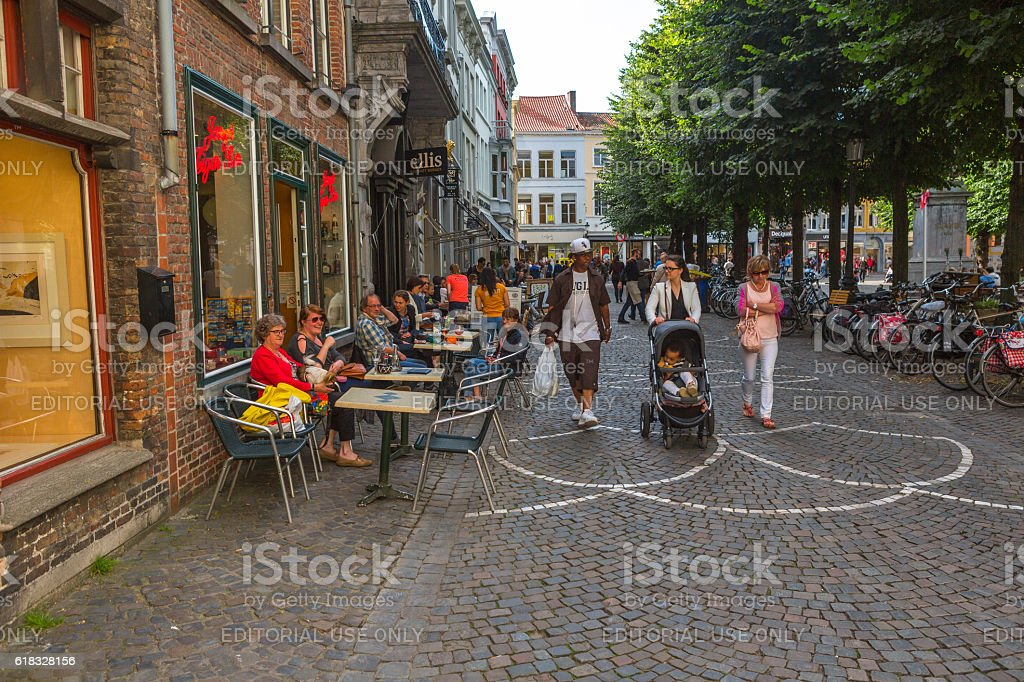 People  at street daytime in summer at brugge belgium stock photo
