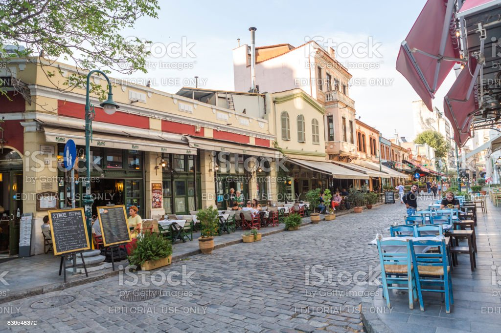 People at street of historical city with traditional houses and restaurants at Thessaloniki greece stock photo