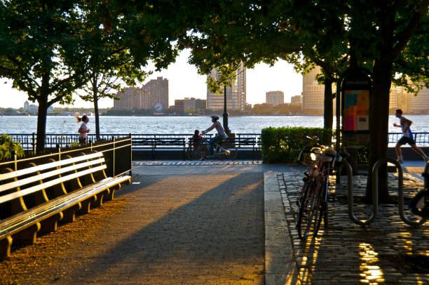 People at Sunset along Battery Park City Promenade, NYC stock photo