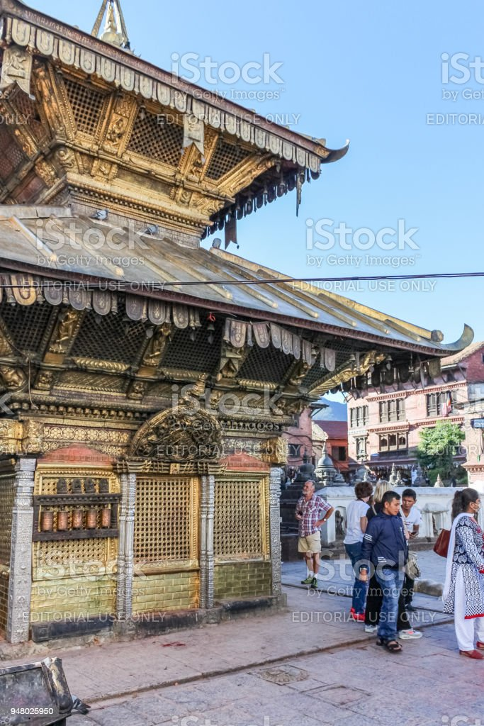 People at Swayambhunath Buddhist temple also called Monkey Temple on a sunny day, Nepal stock photo