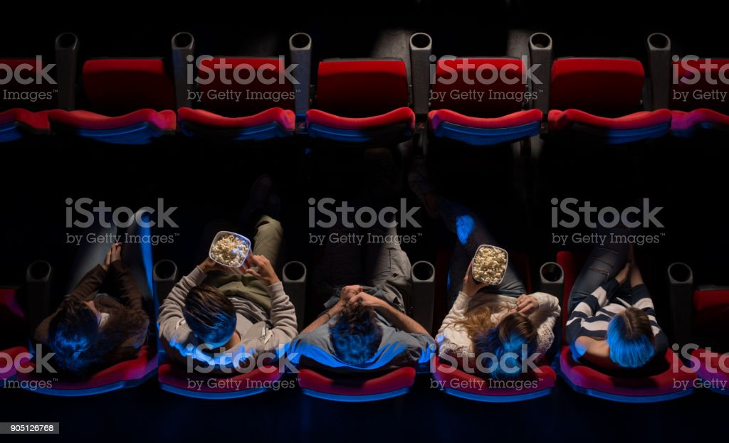 People at the cinema top view stock photo