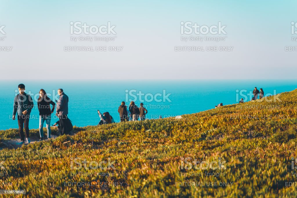 People at the edge of europe at sunset, Cape Roca, Ocean and...