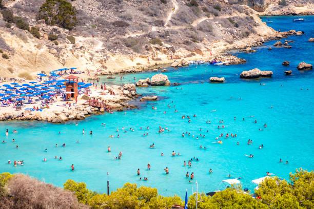 people at the famous beach of konnos bay beach near protaras, ayia napa. famagusta district, cyprus - cyprus стоковые фото и изображения