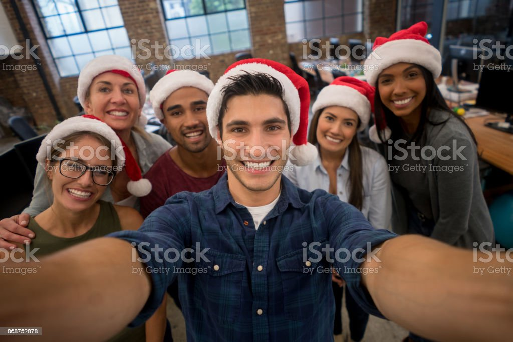 People at the office taking a selfie celebrating Christmas stock photo