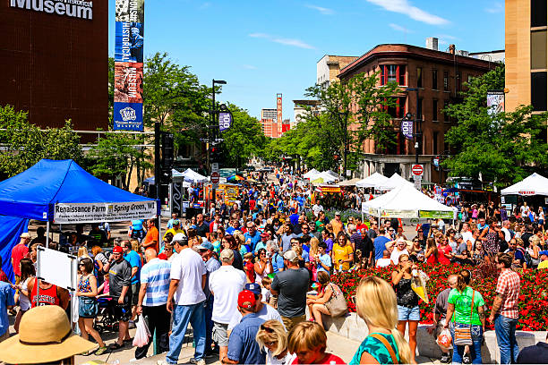 People at the Saturday Farmers Market in Madison Wisconsin Madison, WI, USA - August 1, 2015: Crowds of people at the Saturday Farmers Market in downtown Madison Wisconsin dane county stock pictures, royalty-free photos & images