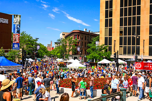 People at the Saturday Farmers Market in Madison Wisconsin Madison, WI, USA - August 1, 2015: Crowds of people at the Saturday Farmers Market in downtown Madison Wisconsin madison wisconsin stock pictures, royalty-free photos & images