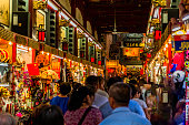 People visiting the Wangfujing Snack Street in Beijing. It is a night market with many stalls selling street snacks.,East Asia,Nikon D3x