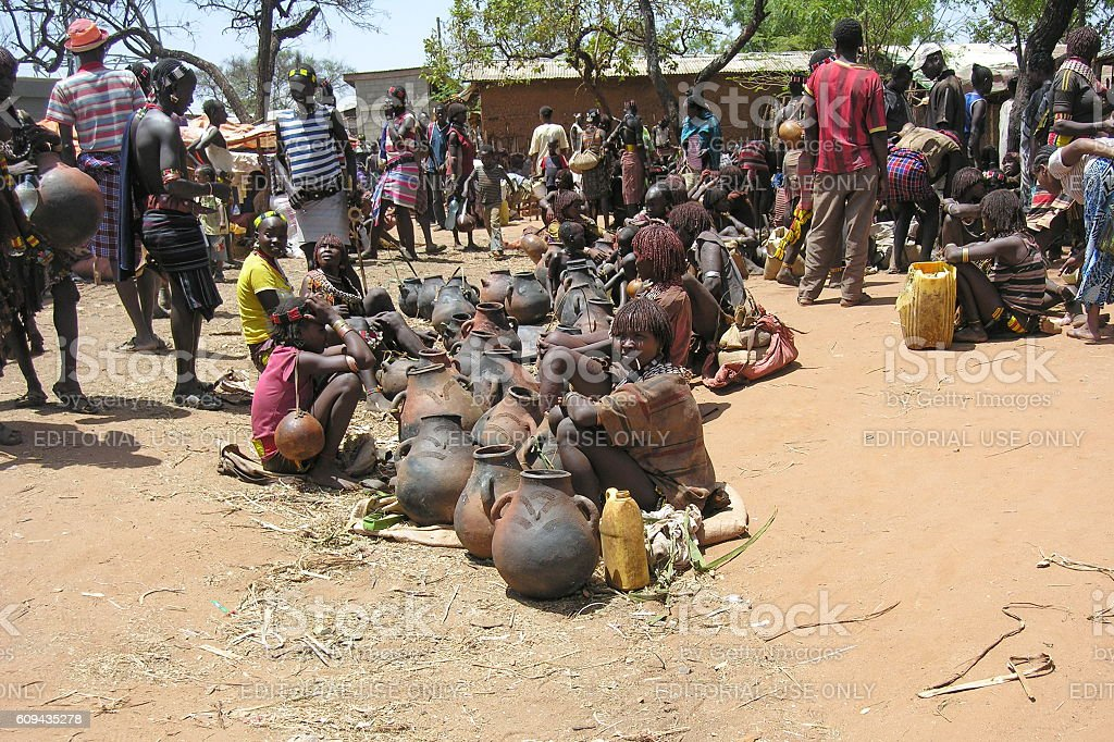 People at traditional Hamer market in Dimeka, Valley Omo, Ethiopia. stock photo