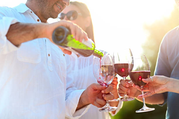 people at wine outdoor party - traditional festival stock photos and pictures