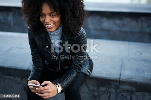 istock People at work and wireless connection to internet in free wifi zone outside 695448934
