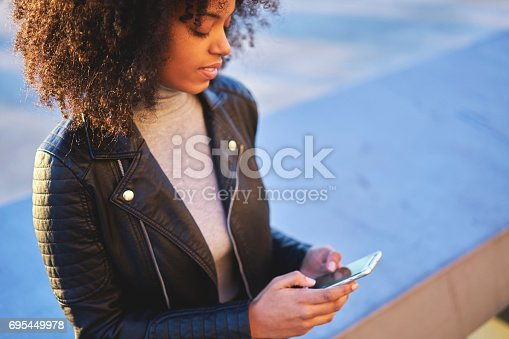 istock People at work files with followers via modern smartphone connected to wifi 695449978