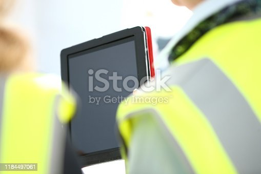 994878714 istock photo people at work with a table and papers 1184497061