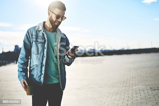 istock People at workconnected to fast 4G internet enjoying strolling with cup of coffee 695450592