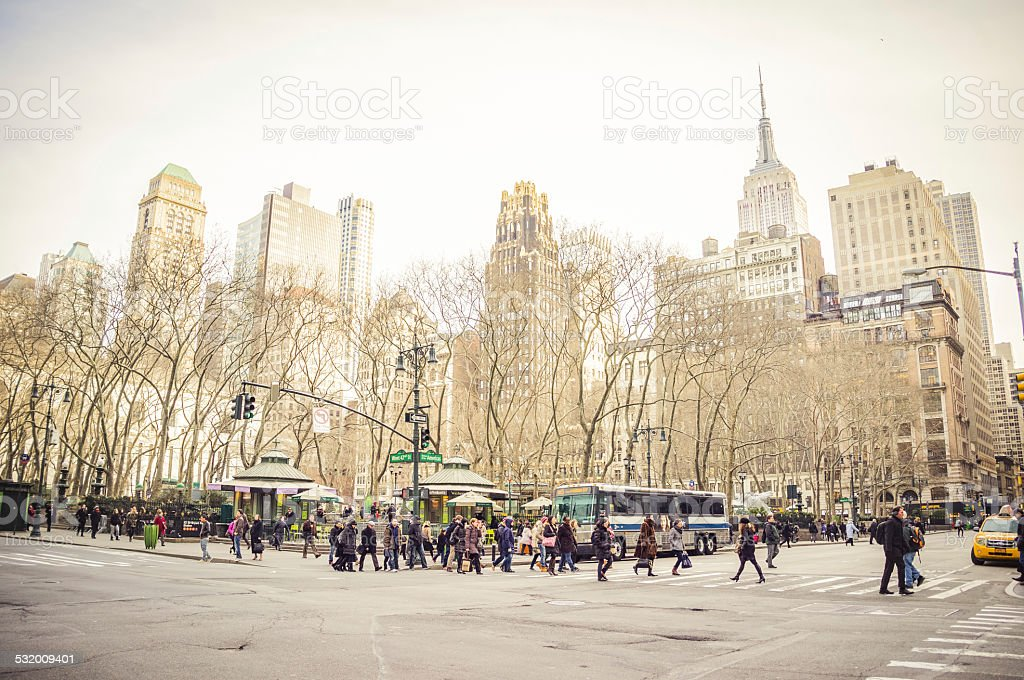 People at zebra crossing on 42nd Street at Bryant Park stock photo