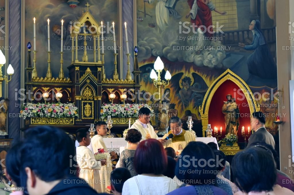 People attend a religious ceremony in the temple at Christian Church,Roman catholic in Thailand stock photo