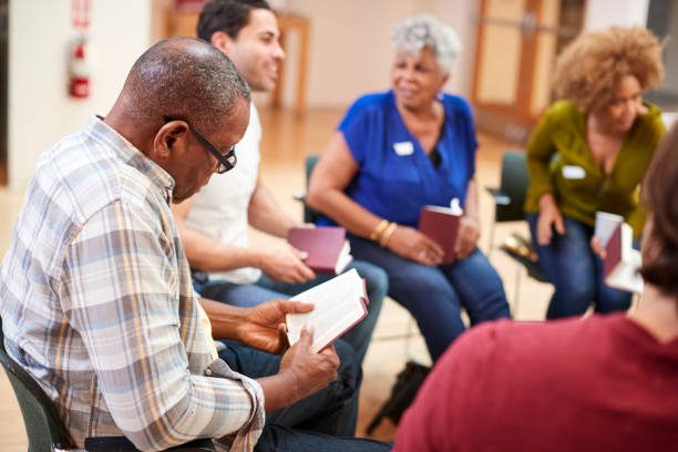 People Attending Bible Study Or Book Group Meeting In Community Center People Attending Bible Study Or Book Group Meeting In Community Center community center stock pictures, royalty-free photos & images