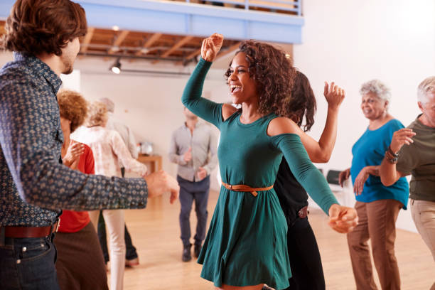 People Attending Dance Class In Community Center People Attending Dance Class In Community Center community center stock pictures, royalty-free photos & images
