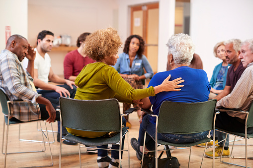 istock People Attending Self Help Therapy Group Meeting In Community Center 1145051503