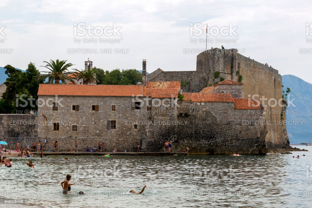 People bathe and rest near the ancient fortress of St. Mary stock photo
