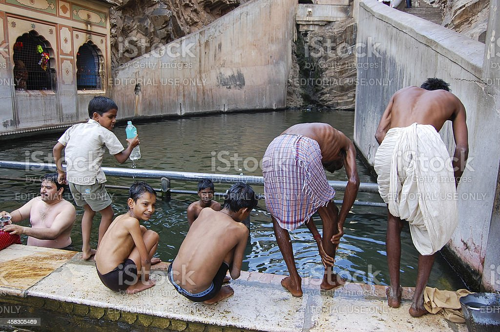 People bathing in sacred water tanks of Monkey Temple. royalty-free stock photo