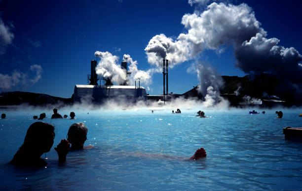 people bathing in the blue lagoon - hot spring stock photos and pictures