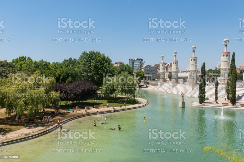 People bathing in the pond of Industrial park in Sants district, Barcelona, Spain stock photo