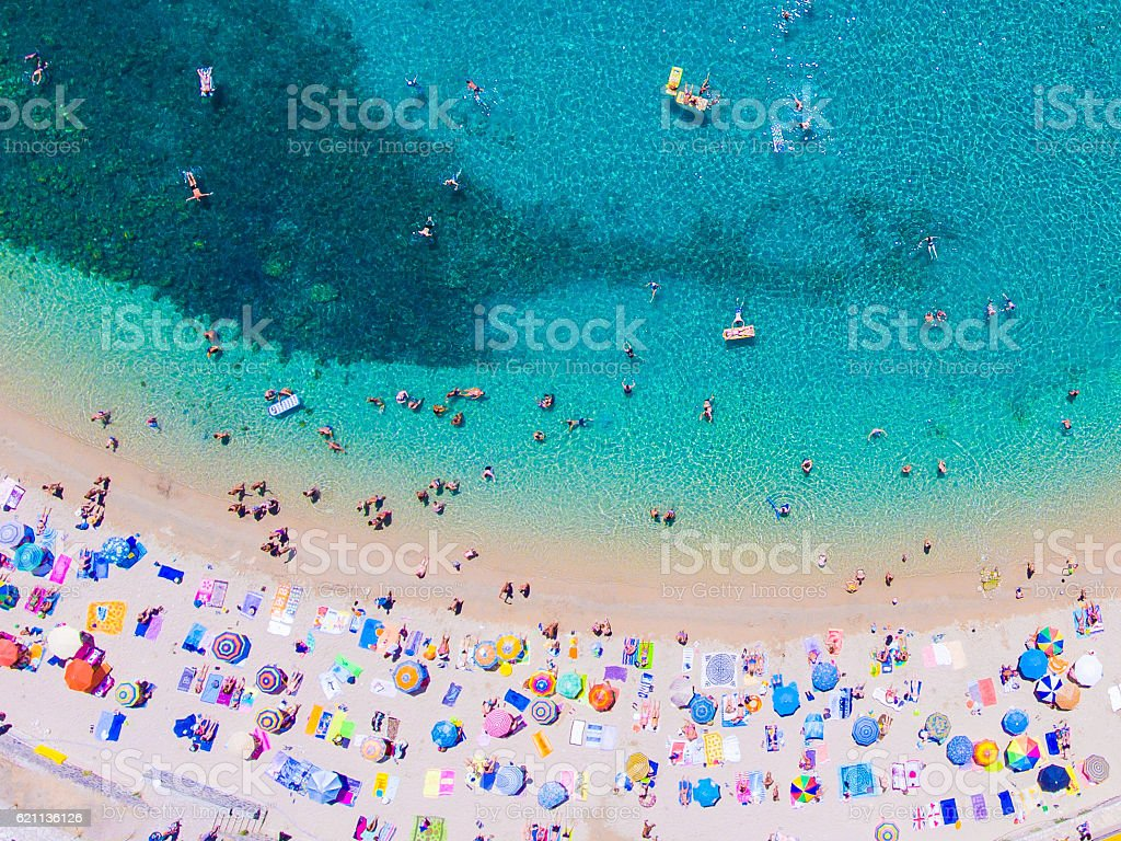 People bathing in the sun at the beach, aerial view stock photo