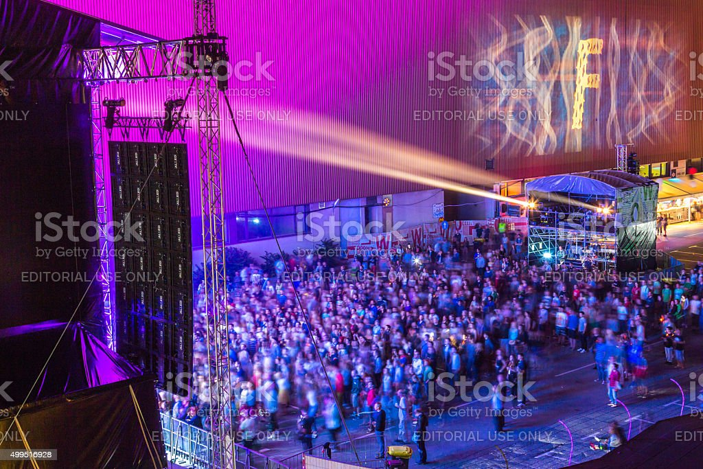 People before the stage at night. stock photo