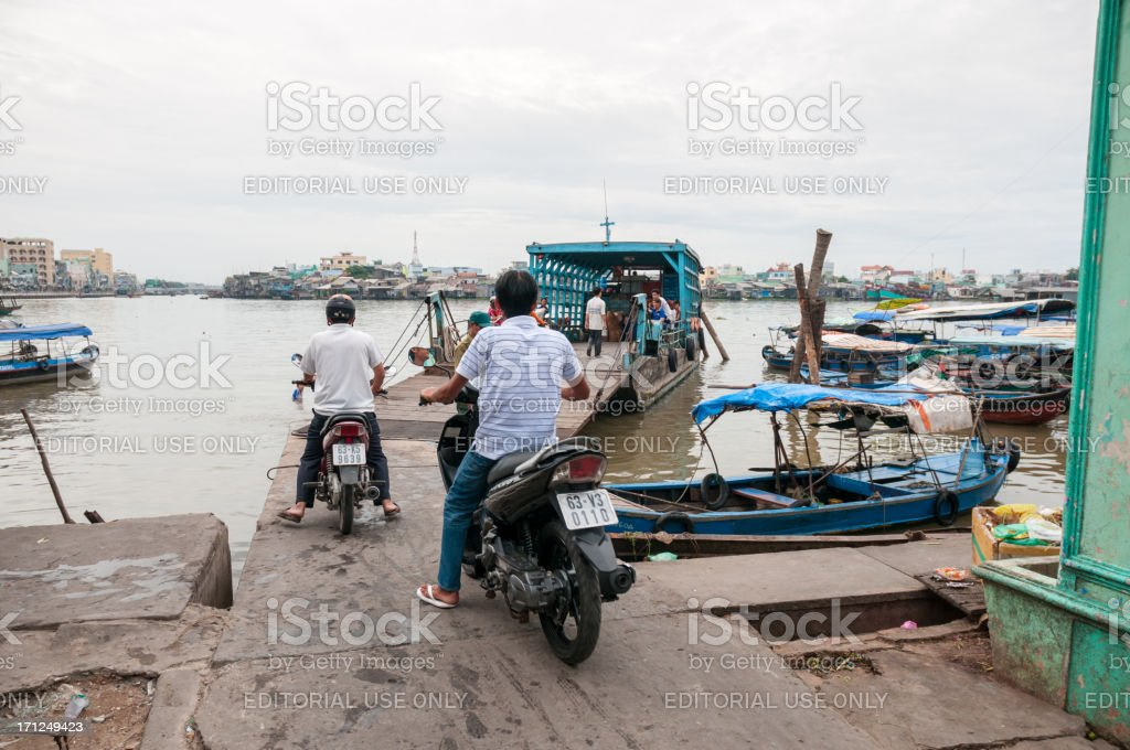 People Boarding A Ferry In My Tho, Vietnam stock photo