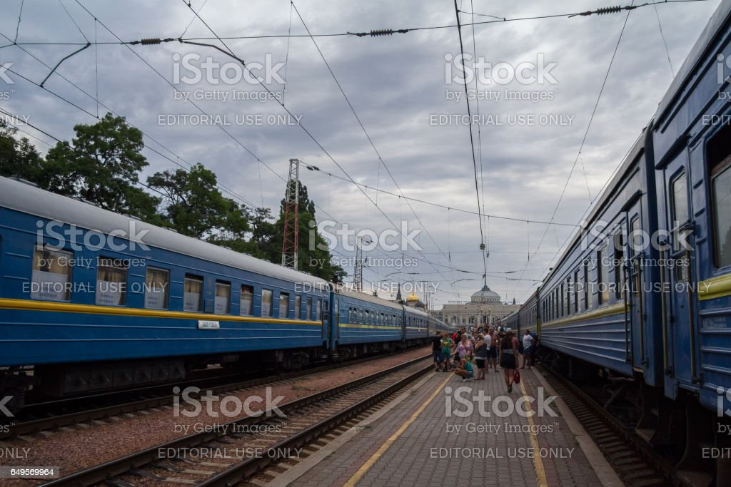Odessa, Ukraine - August  13, 2015: People boarding a train on the platforms of Odessa train station stock photo