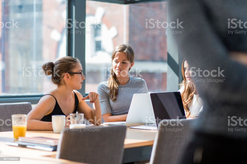 People brainstorming new business strategies in the office stock photo