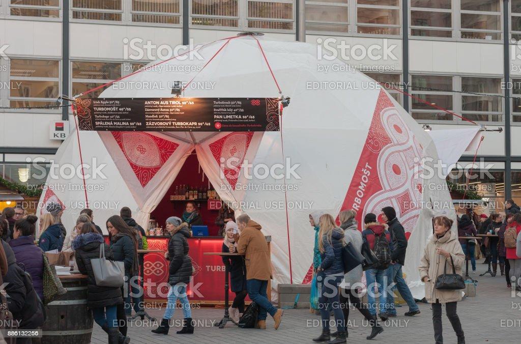 People browsing market stalls at Christmas market stock photo