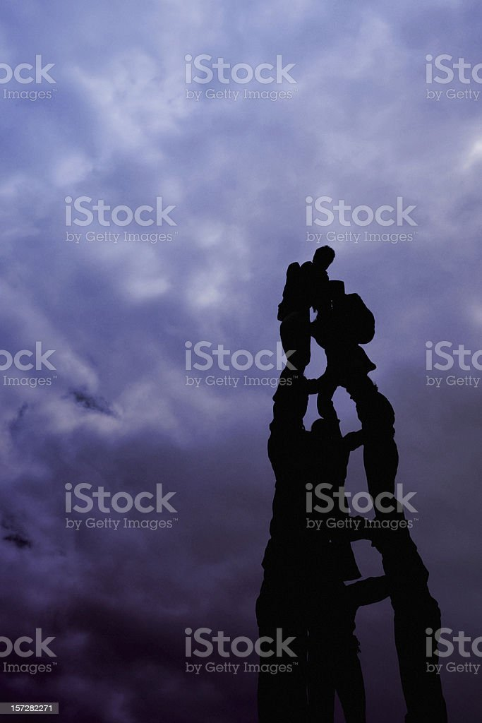 People building a human castle stock photo