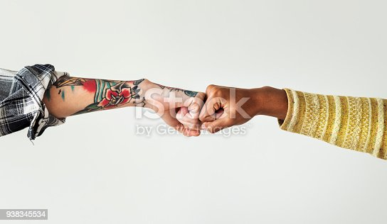 istock People bumping their fists together 938345534