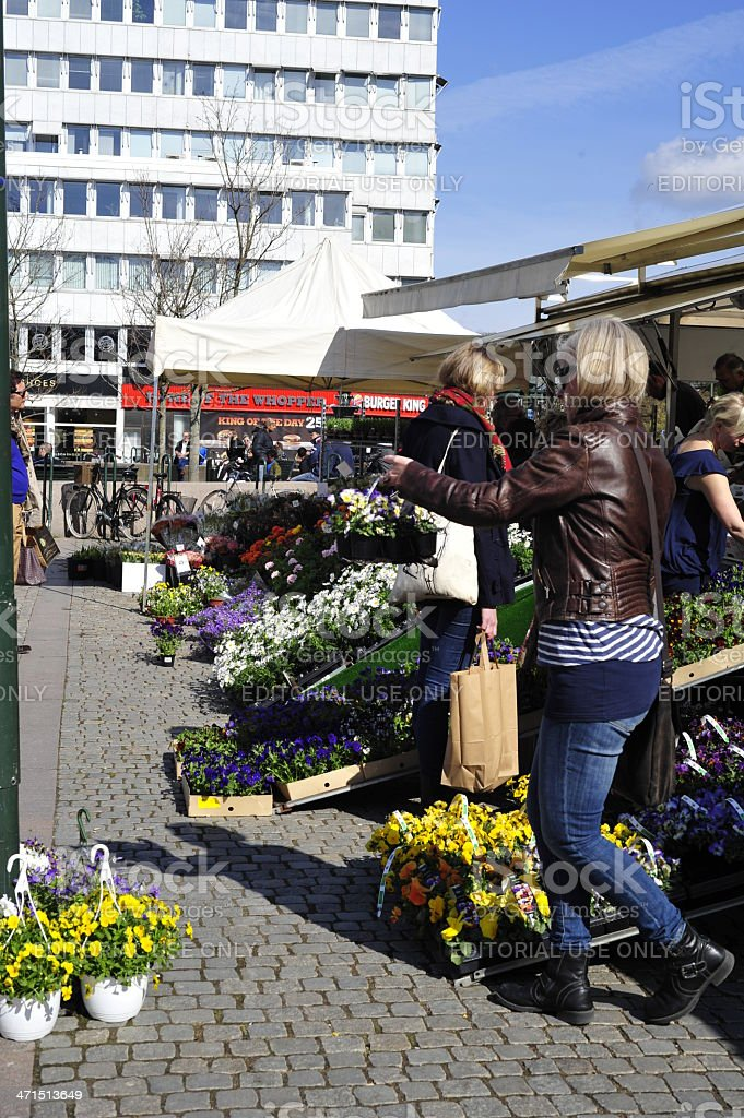 People buy flowers on the street royalty-free stock photo