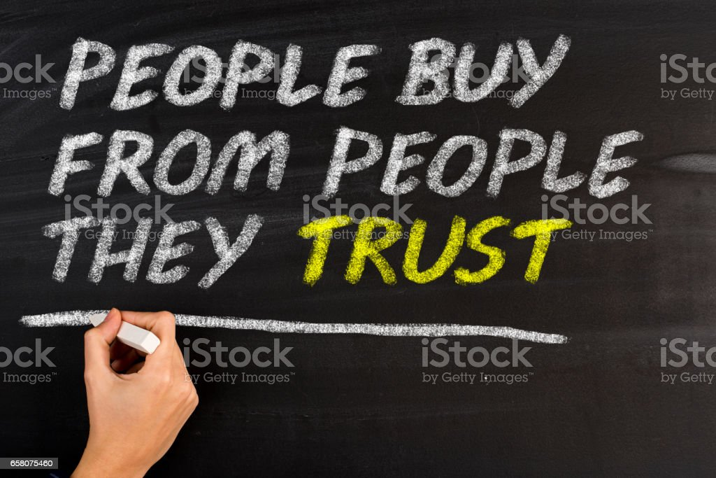 People Buy From People They Trust stock photo