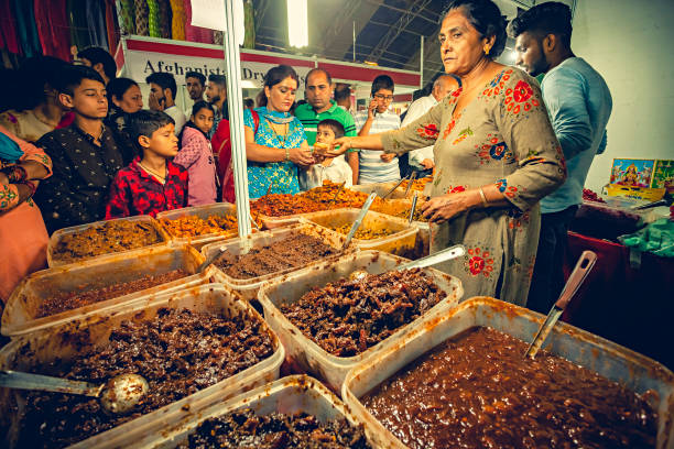 People buy from the stall of spicy pickles in Himachal Utsav fair. stock photo