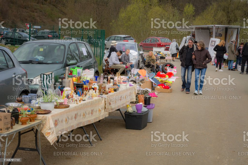 People buying and selling Annual Rural brocante market in...