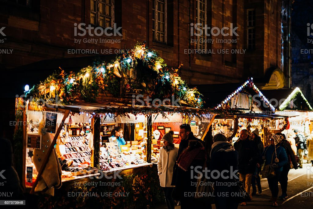 people buying at christmas market traditional gifts and souvenir royalty free stock photo