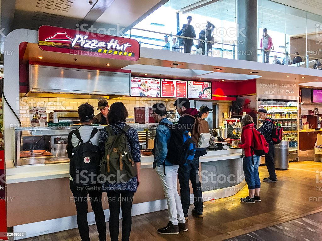 People buying food at Pizza Hut Express, Oslo Airport stock photo