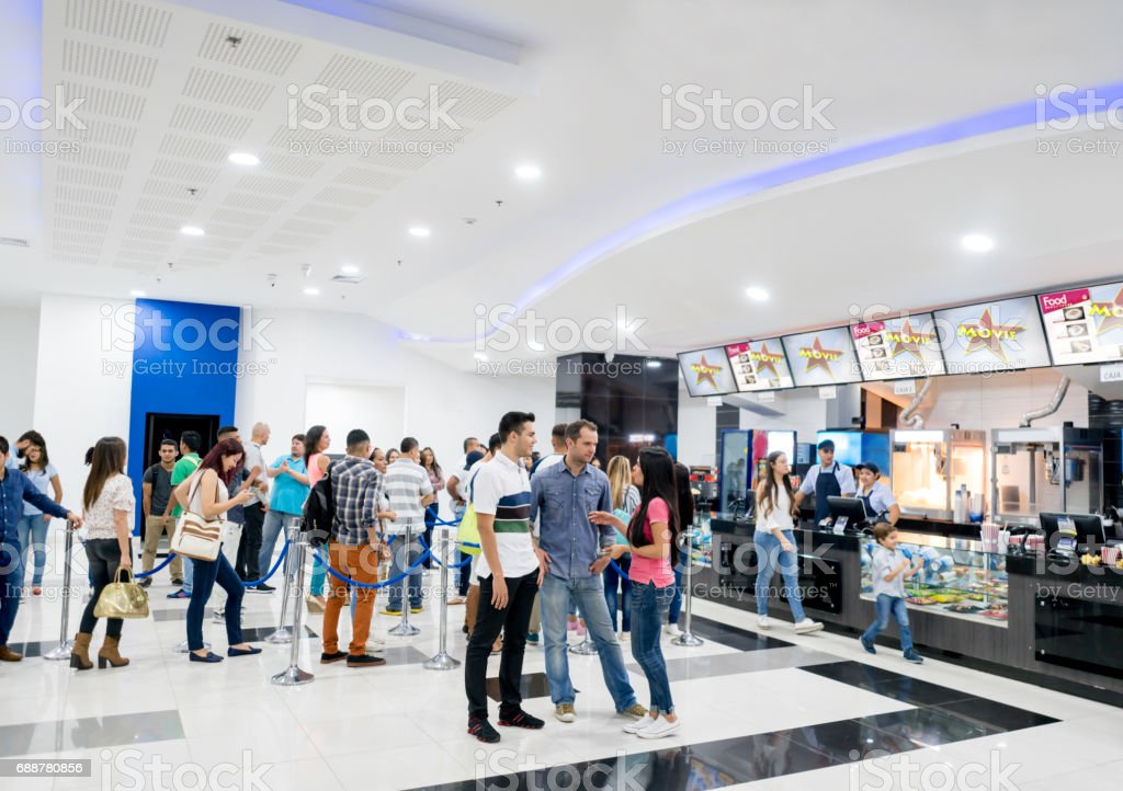 People buying food at the cinema before watching a movie stock photo