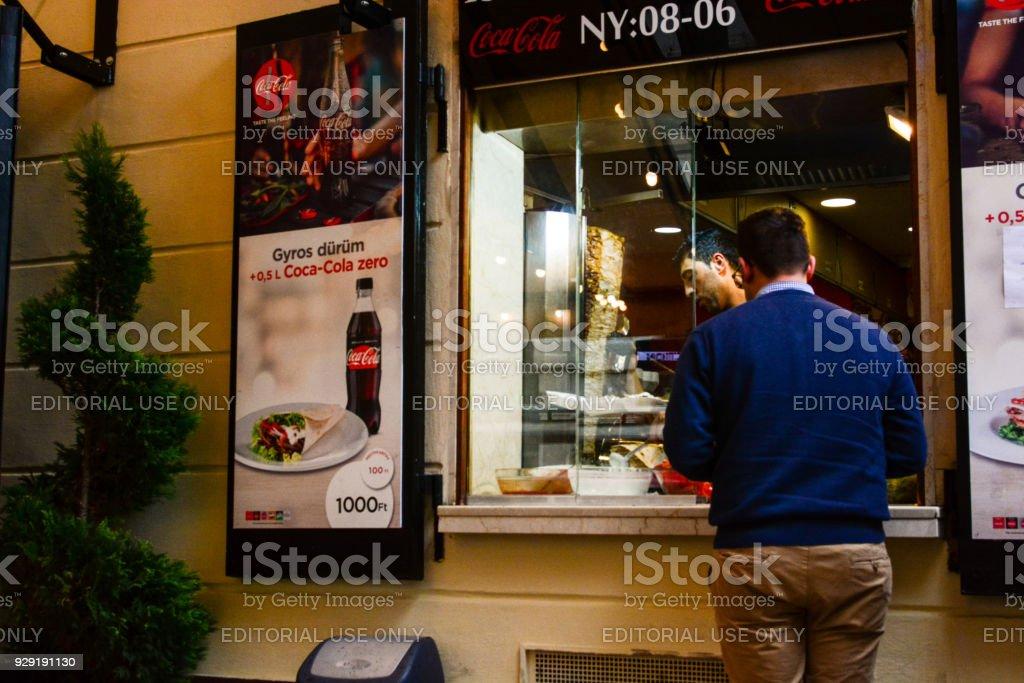 People buying kebap on the street of European city stock photo