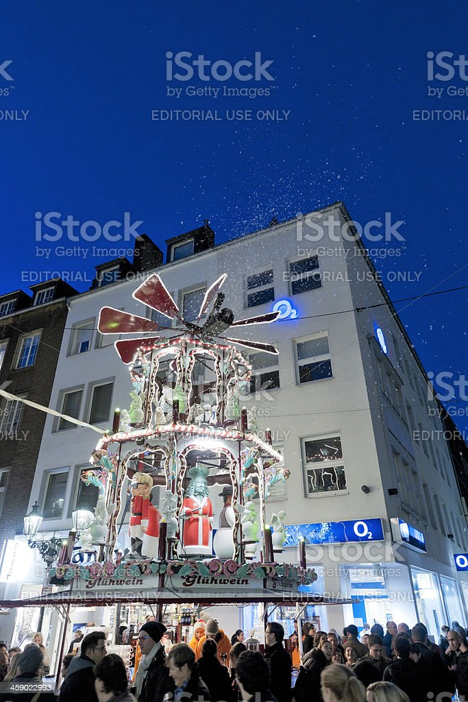 people buying mulled wine at Christmas Market in Dusseldorf Germany stock photo