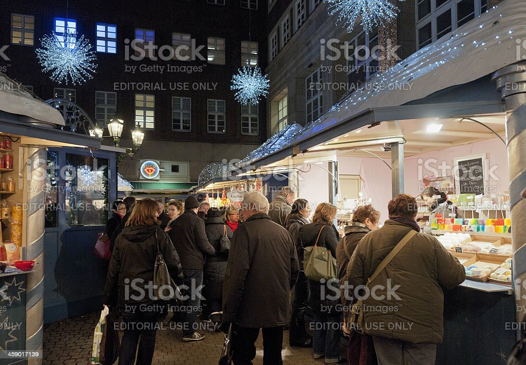 people buying scented toiletries at Christmas Market, Dusseldorf stock photo
