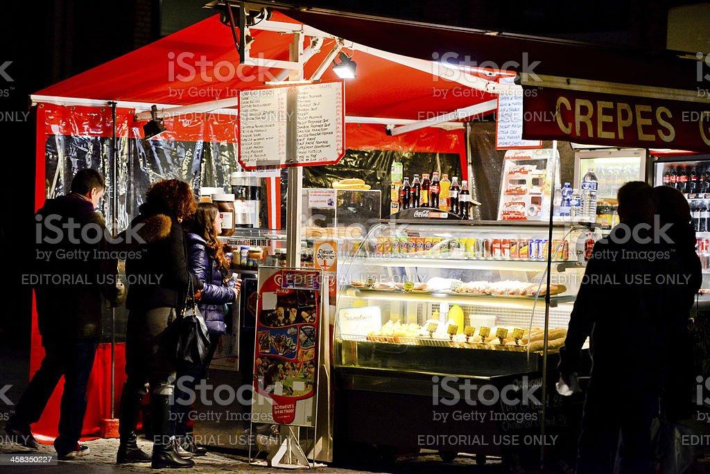 People buying snacks at night. Paris royalty-free stock photo