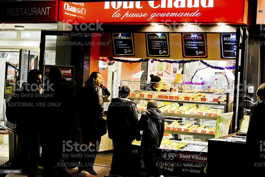 People buying snacks at night. Paris royalty-free stock photo