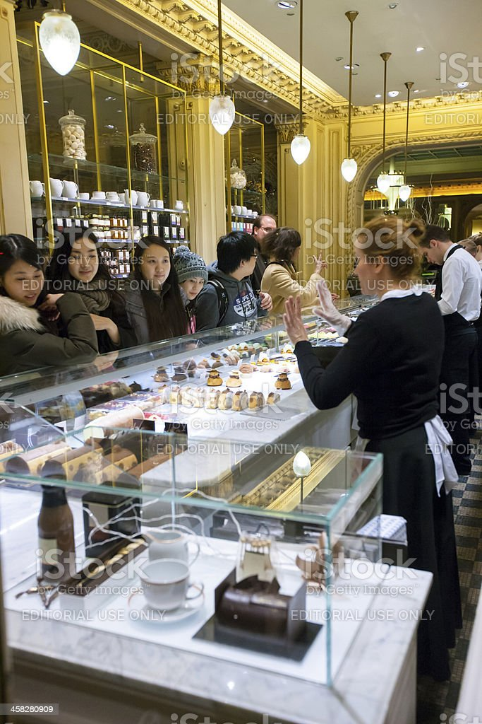 People buying sweets at famous Angelina, Paris royalty-free stock photo